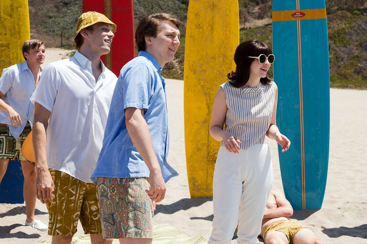 """This photo provided by Roadside Attractions shows, Brett Davern, from left, as Carl Wilson, Jake Abel, as Mike Love, Paul Dano as Brian Wilson and Erin Darke as Marilyn Wilson, in a scene from the film, """"Love & Mercy."""" (Francois Duhamel/Roadside Attractions via AP)"""