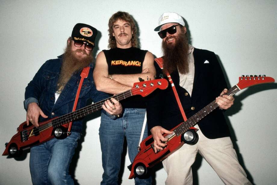 UNITED KINGDOM - AUGUST 20:  Photo of Billy GIBBONS and ZZ TOP and Dusty HILL and Frank BEARD; L-R: Dusty Hill, Frank Beard and Billy Gibbons - posed, group shot, backstage at Monsters Of Rock, Hot Rod shaped guitars, novelty guitars,  (Photo by Fin Costello/Redferns) Photo: Redferns