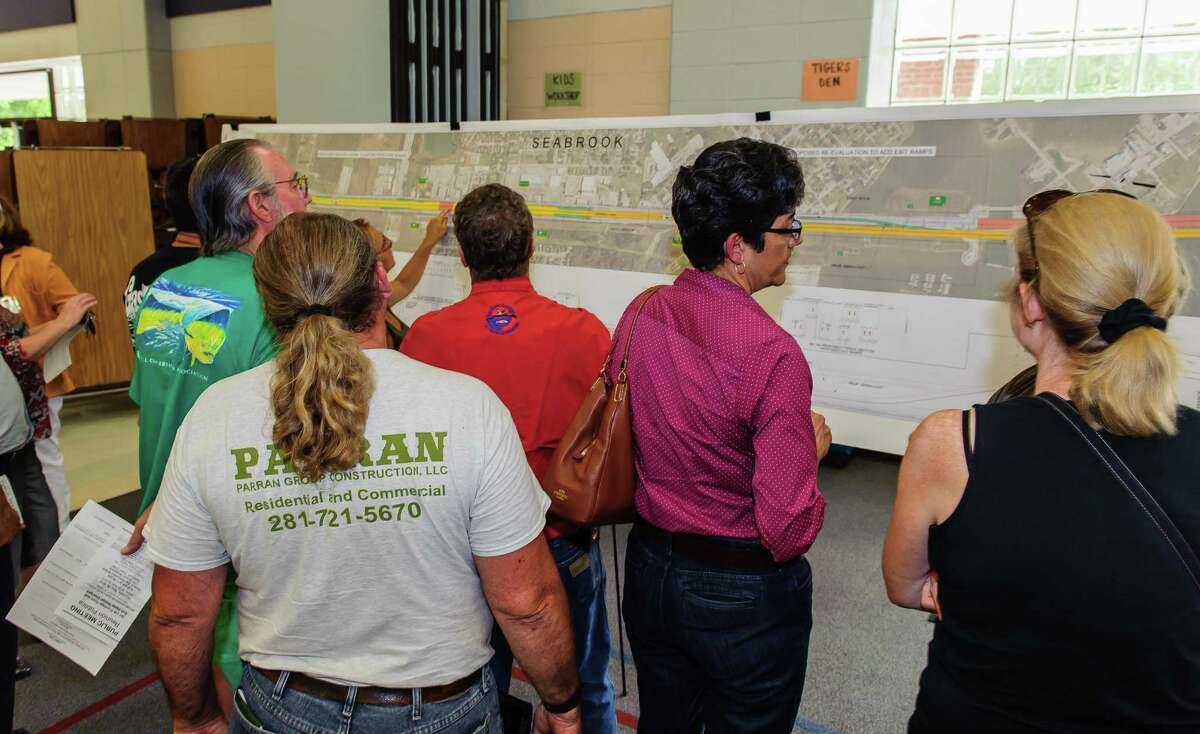 Concerned residents look over maps at the Texas Department of Transportation's public meeting May 28 at James F. Bay Elementary in Seabrook, on the Texas 146 expansion from Red Bluff Road through Seabrook to FM 518.