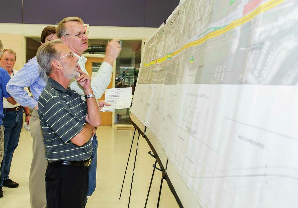 KC Broils and Pastor Rob Purdy with Seabrook Baptist look over maps at TxDOT Public Meeting regarding SH 146 Expansion at James F. Bay Elementary in Seabrook, Texas. (Photos by ÂKim Christensen)