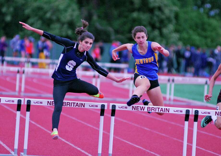 Staples' Olivia Wiener, left, and Newtown's Makenna Cerney compete in the 300 meter finals at the Class LL outdoor track and field championships on Tuesday, June 2, 2015 at Willow Brook Park in New Britian, Connecticut. Cerney finished second and Wiener finished third. Photo: Ryan Lacey/Staff Photo / Westport News Contributed