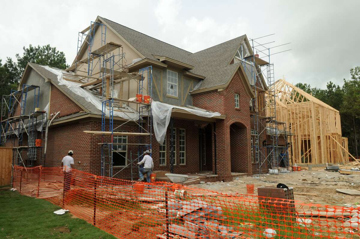 Home construction continues in Creekside Park in The Woodlands.