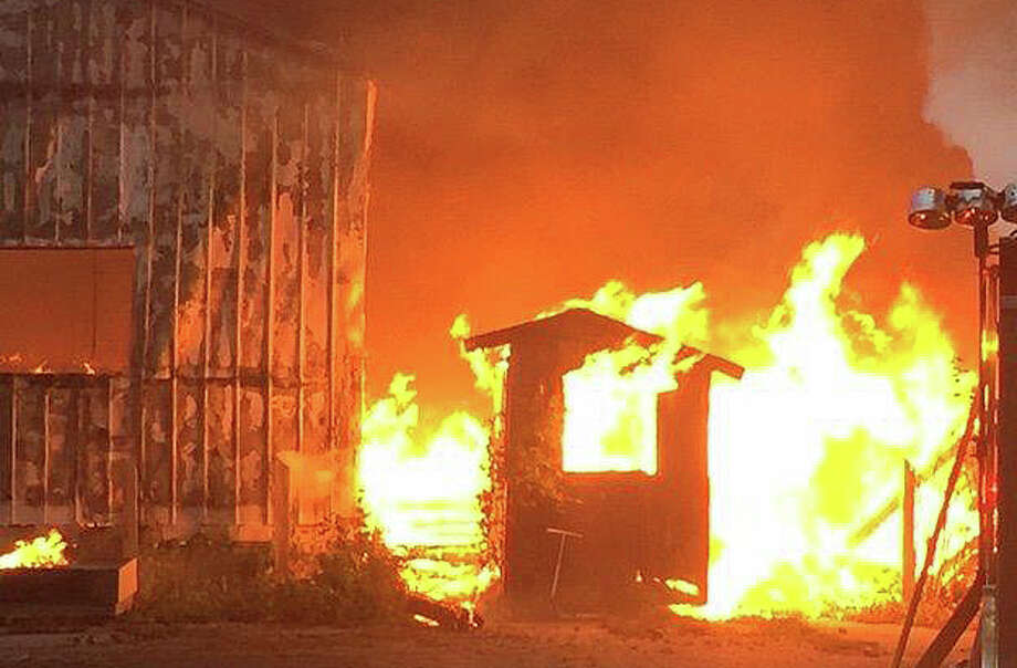 A wall of flames engulfs one of the buildings remaining on the property of the former Fairfield Lumber yard during fire that swept through the Thorpe Street complex. Photo: Fairfield Police Department / Fairfield Citizen