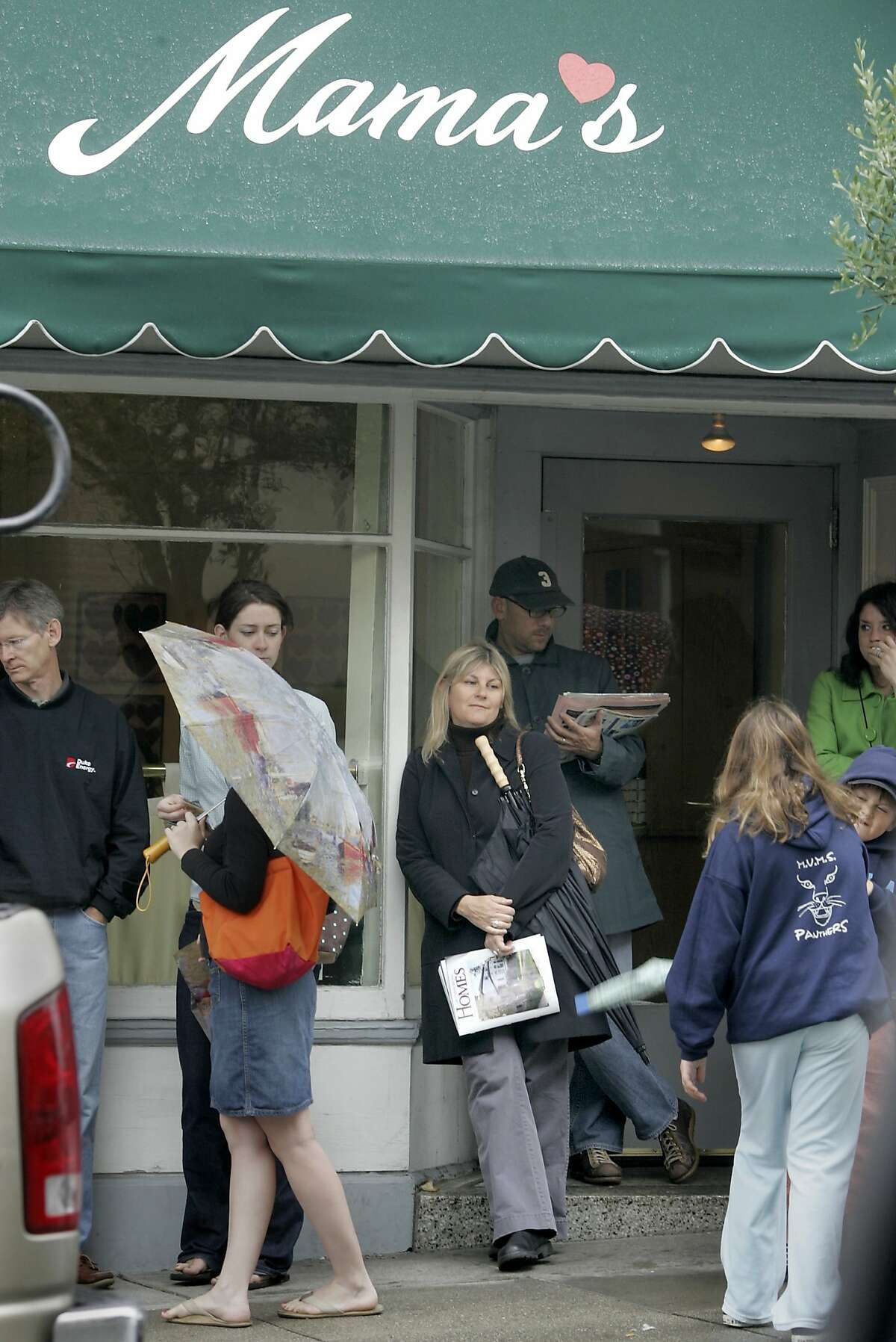 mothers579_ward.jpg What better place to celebrate Mother's Day than at Mama's in North Beach. Ruth Rosenfield, center blonde hair, watched her two children playing as she and others waited patiently to get inside. On a very wet and cold Mother's Day, most would not let the bad weather dampen their plans. From North Beach to the Mission district, families and mother's celebrated the special day. Brant Ward 5/9/05