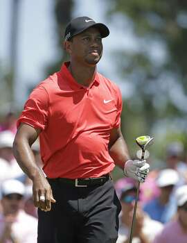 Tiger Woods watches his shot from the 16 tee during the final round of The Players Championship golf tournament Sunday, May 10, 2015, in Ponte Vedra Beach, Fla. (AP Photo/Lynne Sladky)