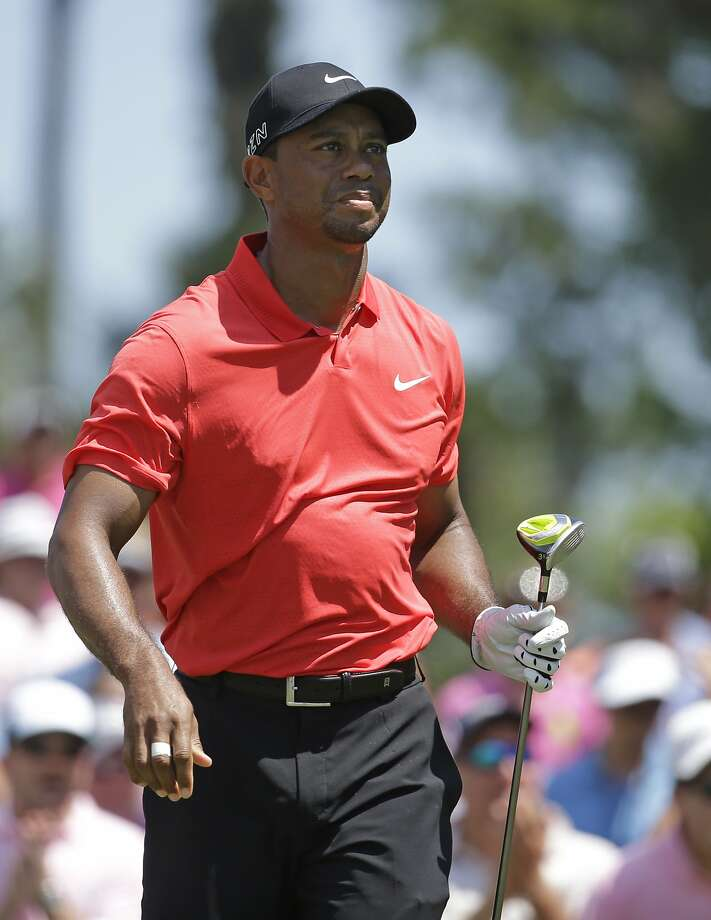 Tiger Woods watches his shot from the 16 tee during the final round of The Players Championship golf tournament Sunday, May 10, 2015, in Ponte Vedra Beach, Fla. (AP Photo/Lynne Sladky) Photo: Lynne Sladky, Associated Press