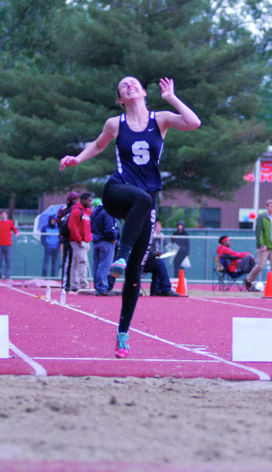 Staples' Bridget van Dorsten competes in the long jump at the Class LL outdoor track and field championships on Tuesday, June 2, 2015 at Willow Brook Park in New Britian. Photo: Ryan Lacey/Staff Photo / Westport News Contributed