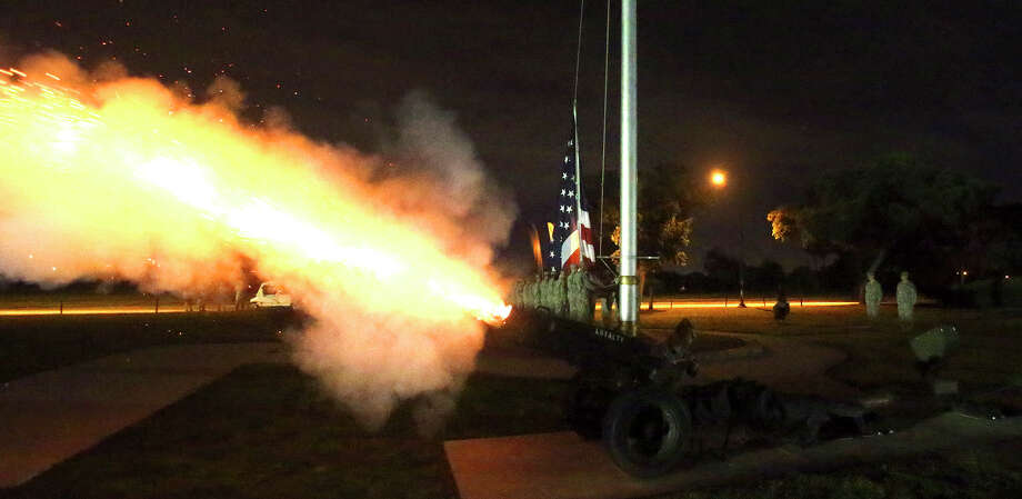 A cannon is fired at 5:30 a.m. Wednesday June 3, 2015 at Joint Base San Antonio-Fort Sam Houston before the American flag is raised. More than 5,000 runners converged at the post to take part in a mass formation run on a 3.5 mile circuit to kick off celebrations for the U.S. Army's 240th birthday celebration. The run is the first of several events area Army units are planning to take part in for the celebration and other events will include a formal ball on June 13 as well as several cake cutting ceremonies at Ft. Sam Houston and Camp Bullis. The United States Army was officially established by the First Continental Congress on June 14, 1775. Photo: John Davenport, San Antonio Express-News / ©San Antonio Express-News/John Davenport