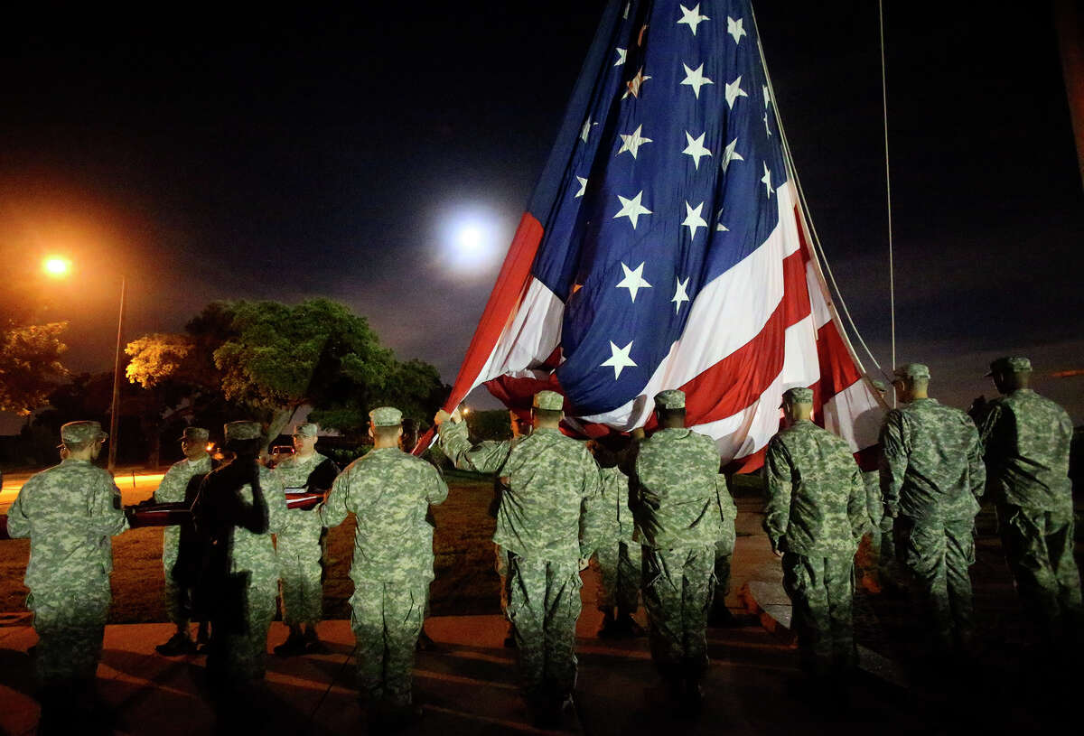 Soldiers prepare to raise the American flag at 5:30 a.m. Wednesday June 3, 2015 at Joint Base San Antonio-Fort Sam Houston before a celebration of the U.S. Army's birthday. More than 5,000 runners converged at the post to take part in a mass formation run on a 3.5 mile circuit to kick off celebrations for the U.S. Army's 240th birthday celebration. The run is the first of several events area Army units are planning to take part in for the celebration and other events will include a formal ball on June 13 as well as several cake cutting ceremonies at Ft. Sam Houston and Camp Bullis. The United States Army was officially established by the First Continental Congress on June 14, 1775.