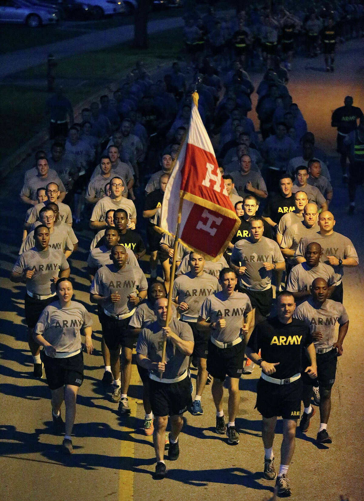 Army soldiers run at 5:30 a.m. Wednesday June 3, 2015 at Joint Base San Antonio-Fort Sam Houston after the American flag was raised and a cannon was fired. More than 5,000 runners converged at the post to take part in a mass formation run on a 3.5 mile circuit to kick off celebrations for the U.S. Army's 240th birthday celebration. The run is the first of several events area Army units are planning to take part in for the celebration and other events will include a formal ball on June 13 as well as several cake cutting ceremonies at Ft. Sam Houston and Camp Bullis. The United States Army was officially established by the First Continental Congress on June 14, 1775.