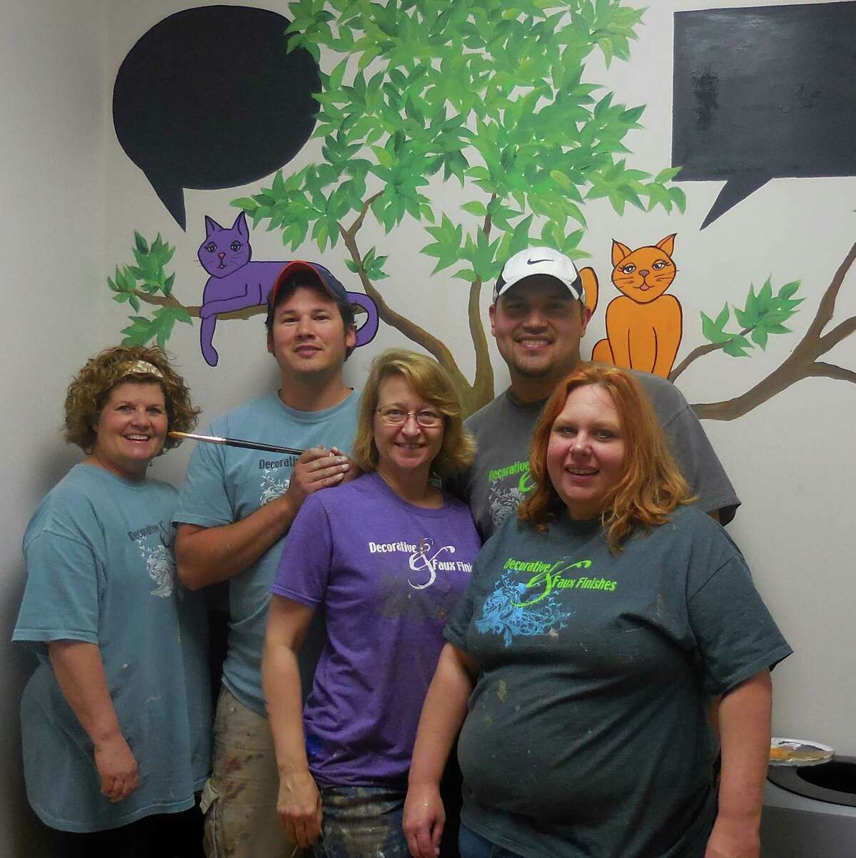 Decorative & Faux Finishes and Heritage Paints decorated the Missouri City Animal Shelter. From left, front row are Dana Debuck, co-owner; Cindy Howard co-owner, and Nancy Parsons, employee; Back row: Chris Garcia and John Hernandez, both employees.