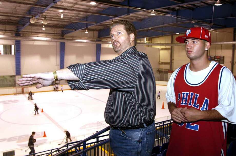 In this August 2004 file photo, James Galante, left, and his son AJ, talk about renovations underway at the Danbury Ice Rink. Galante's professional hockey team, the Danbury Trashers, played at the Danbury arena. Photo: Chris Ware, ST / The News-Times