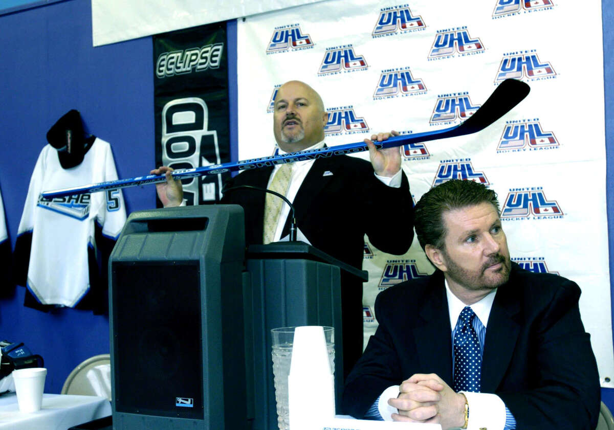 In this file photo, UHL (United Hockey League) president Richard Brosal holds a hockey stick during a press conference announcing the coming of professional hockey to Danbury. The Danbury Trashers owner James Galante is right.