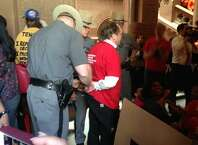 State Police arrest a protestor at the Capitol on Wednesday. (Matt Hamilton / Times Union)