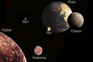 Scientists hope spacecraft clears up mysteries of Pluto - Photo