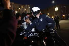 In this May 23, 2015 photo, protesters push against Oakland police as they attempt to continue marching in Oakland, Calif. About 100 people took to the streets in Oakland on Saturday night to protest against what they said was the city's crackdown on nighttime demonstrations.