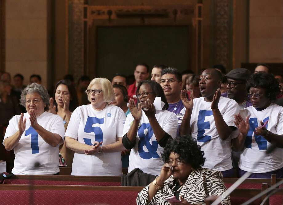 Supporters applaud during the Los Angeles City Council's vote on increasing the minimum wage. Photo: Damian Dovarganes, Associated Press