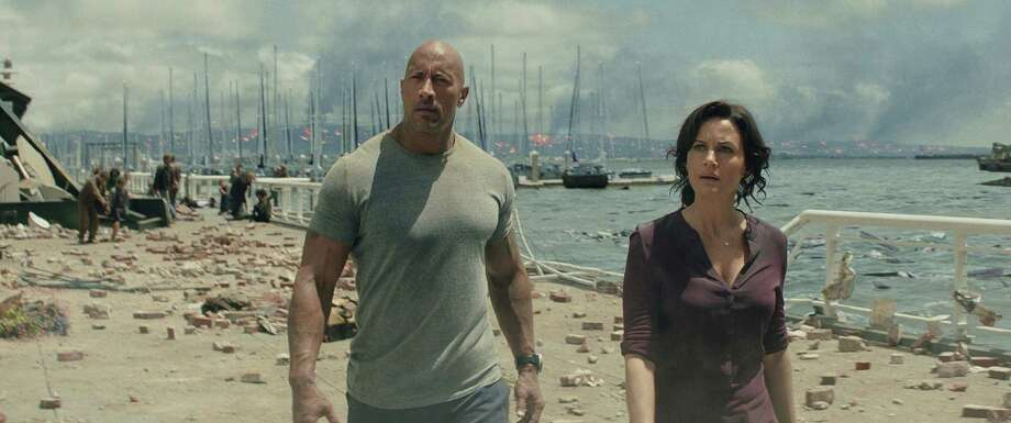 "This photo provided by Warner Bros. Pictures shows Dwayne Johnson, left, as Ray, and Carla Gugino as Emma, in a scene from the action thriller, ""San Andreas."" The movie releases in theaters on May 29, 2015.  (Courtesy Warner Bros. Pictures via AP) ORG XMIT: CAET617 Photo: Courtesy Of Warner Bros. Picture / Warner Bros. Pictures"