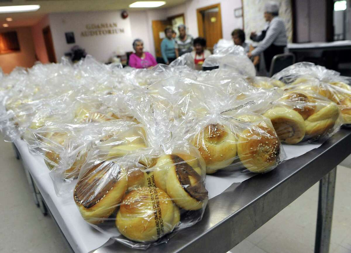 Women take a break after baking and bagging up choereg, an Armenian sweet bread, at St. Peter Armenian Apostolic Church on Wednesday, June 3, 2015 in Watervliet, N.Y. The church is getting ready for its annual Armenian Festival this weekend. (Lori Van Buren / Times Union)
