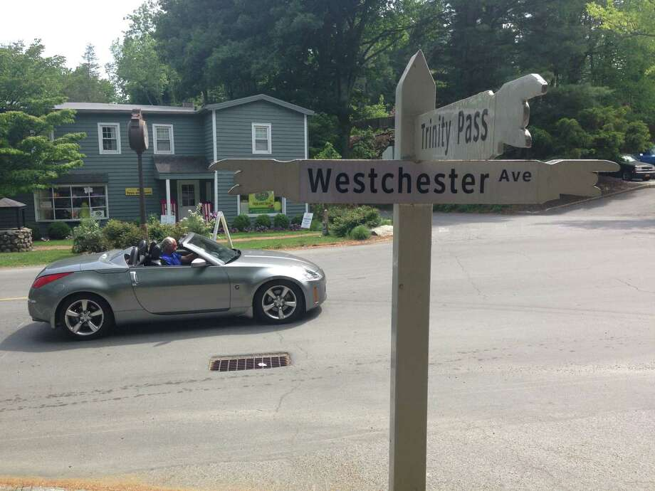 A sign pointing to Westchester Avenue and Trinity Pass in Pound Ridge, N.Y. Photo: Evan Fallor/Westfair / Evan Fallor/Westfair Connecticut Post Contributed