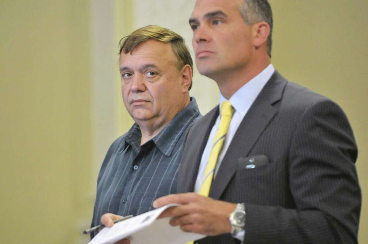 Former City of Rensselaer DPW commissioner Thomas Capuano, left, and his attorney Joe Granich in Rensselaer County Court for Capuano's sentencing on Wednesday, June 3, 2015, in Troy, N.Y. Capuano was sentenced for for stealing scrap metal proceeds. (Paul Buckowski / Times Union)