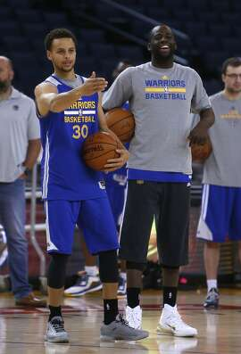 Golden State Warriors' Stephen Curry and Draymond Green during practice at Oracle Arena in Oakland, Calif., on Wednesday, June 3, 2015.
