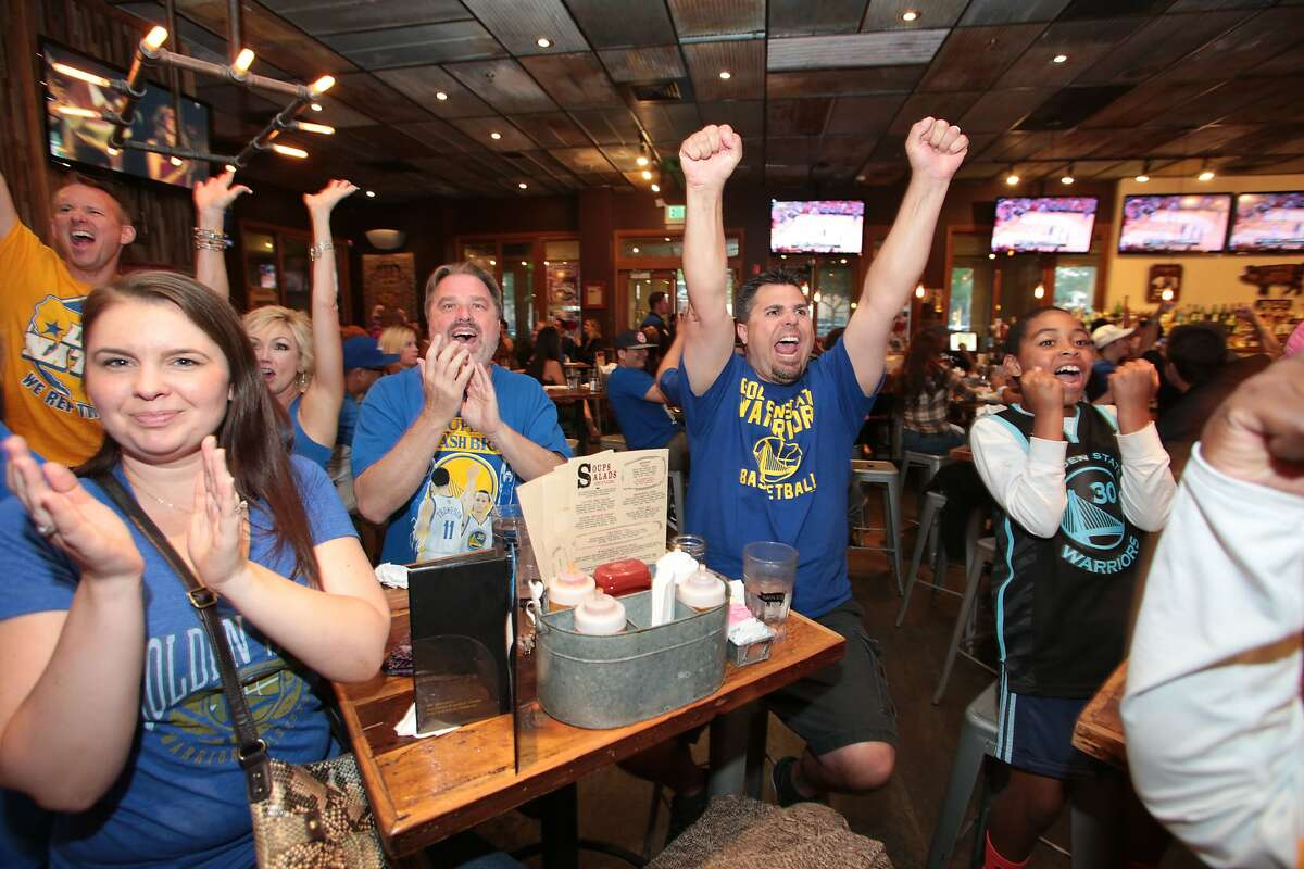 Fans react to Game 4 of the NBA playoffs during a watch party at Sauced BBQ & Spirits on May 25, 2015.