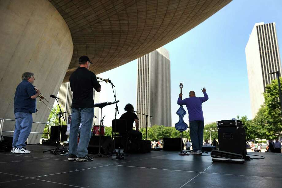 Alex Torres and Friends kicked off the Made in the Shade of the Egg summer performance series on Wednesday, June 3, 2015, at the Empire State Plaza in Albany, N.Y. The free shows are every Wednesday at noon through Aug. 26. (Cindy Schultz / Times Union) Photo: Cindy Schultz / 00031892A