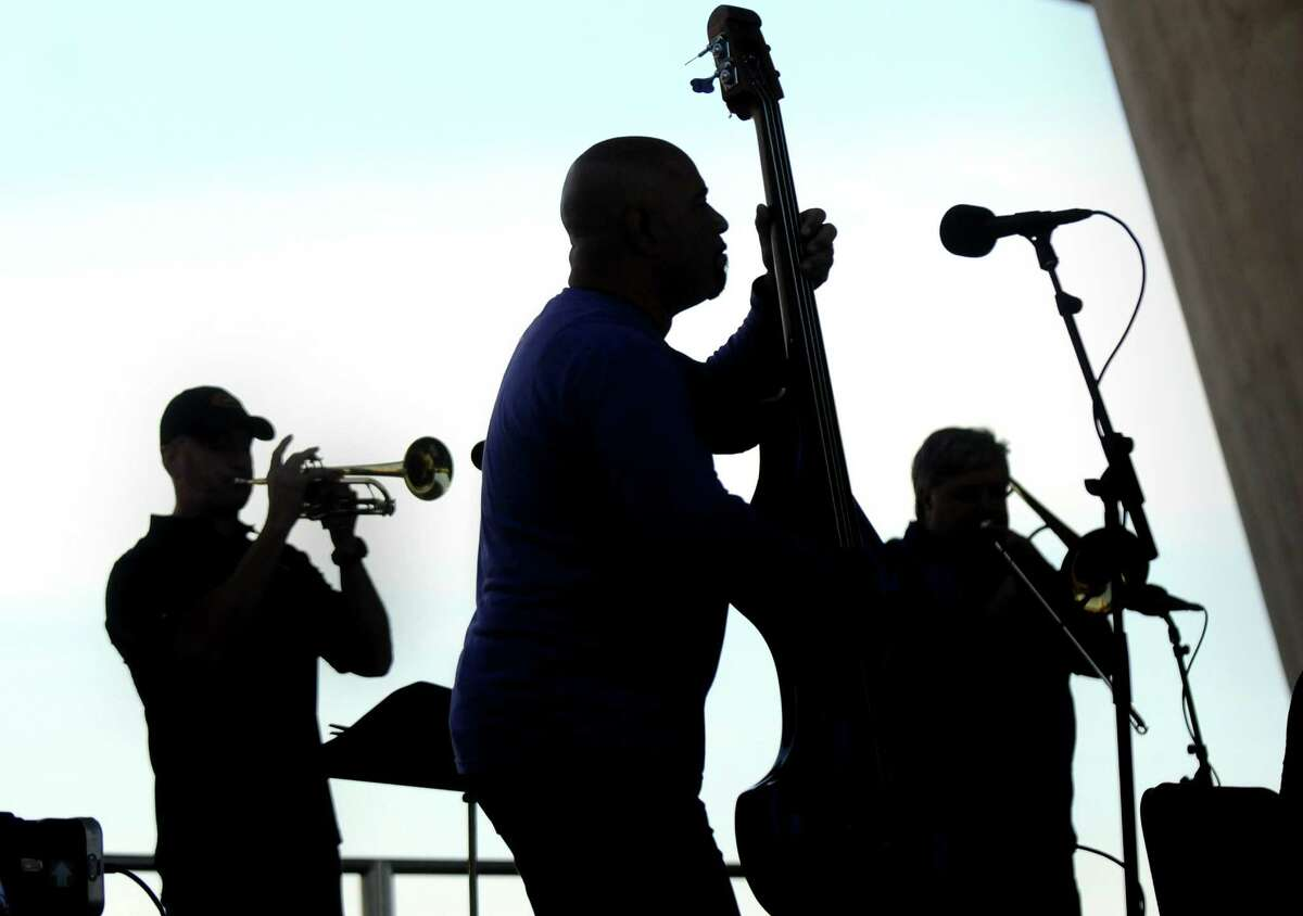 Alex Torres on bass, center, joins Jon Bronk on trumpet, left, and Ken Olsen on trombone during the Made in the Shade of the Egg on Wednesday, June 3, 2015, at the Empire State Plaza in Albany, N.Y. Alex Torres and Friends kicked off the Made in the Shade of the Egg summer performance series. The free shows are every Wednesday at noon through Aug. 26. (Cindy Schultz / Times Union)