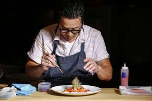 Sho Kamio of Iyasare plots Zut Tavern next door - Photo