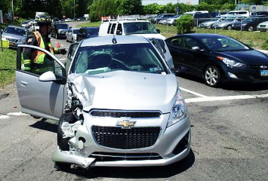 Three people suffered minor injuries in a three-vehicle accident Wednesday morning on the Exit 17 ramp of Interstate 95. Photo: Contributed Photo / westport news