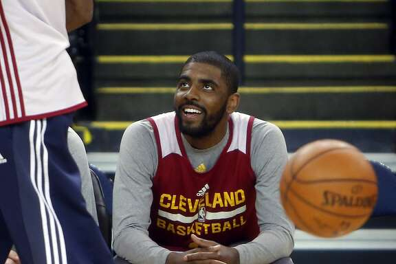 Cleveland Cavaliers' Kyrie Irving watches practice at Oracle Arena in Oakland, Calif., on Wednesday, June 3, 2015.