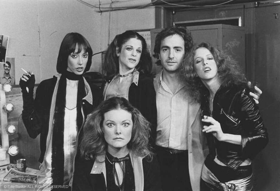 """Backstage in an early """"Saturday Night Live,"""" clockwise from left: host Shelley Duvall, Gilda Radner, Lorne Michaels, Laraine Newman and Jane Curtin. Photo: Courtesy Of Edie Baskin"""