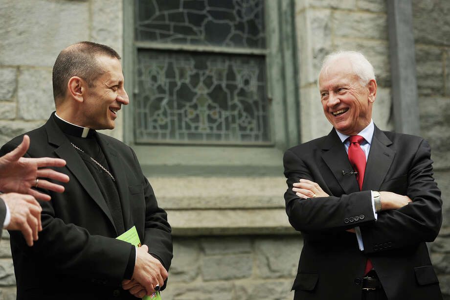 Bishop Frank Caggiano, left, and Cardinal Shehan Center Executive Director Terry O'Connor announce a capital fund campaign to enlarge and improve the center in a press conference outside St. Augustine Cathedral in Bridgeport, Conn. on Wednesday, June 3, 2015. Photo: Brian A. Pounds / Connecticut Post