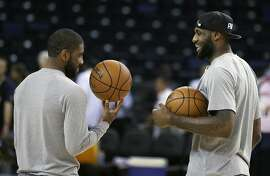 Cleveland Cavaliers' Kyrie Irving, left, and LeBron James talk during NBA basketball practice, Wednesday, June 3, 2015, in Oakland, Calif. The Golden State Warriors host the Cavaliers in Game 1 of the NBA Finals on Thursday. (AP Photo/Ben Margot)