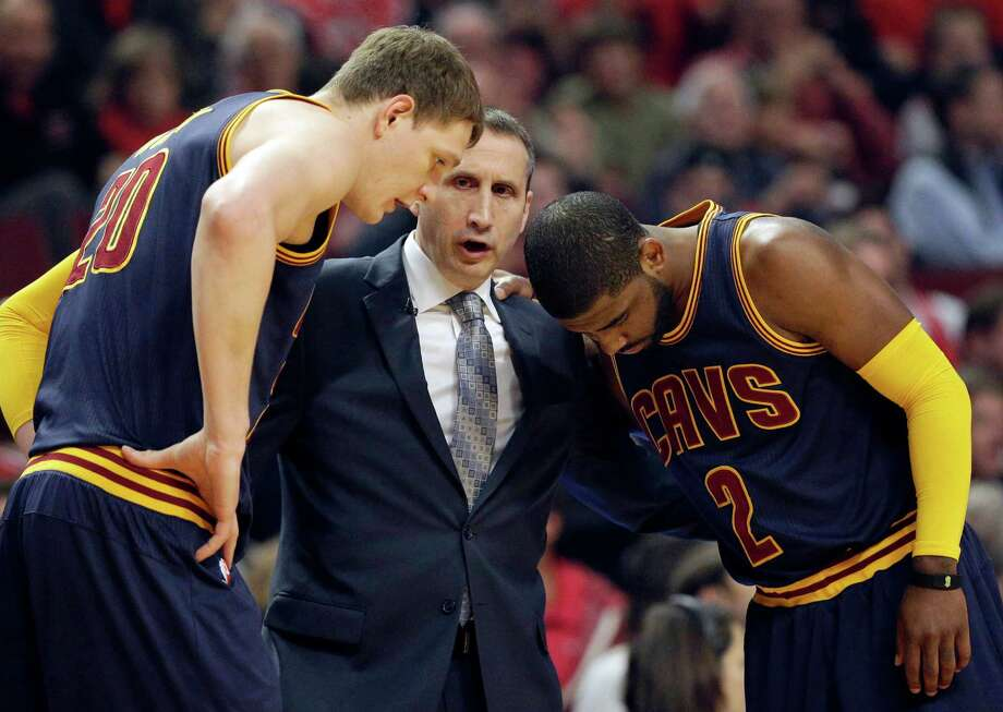 FILE - In this May 14, 2015, file photo, Cleveland Cavaliers head coach David Blatt, center, talks with Timofey Mozgov (20) and Kyrie Irving (2) during the first half of Game 6 in a second-round NBA basketball playoff series against the Chicago Bulls in Chicago. Blatt was handed a star-studded team expected to win an NBA title, but not a handbook on how to get the Cavaliers to the top. For Blatt, who left his family in Israel to pursue his dream, the journey has been difficult with speculation about his future partly undermining his success. (AP Photo/Nam Y. Huh, File) Photo: Nam Y. Huh, STF / Associated Press / AP