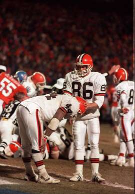 FILE - In this Jan. 17, 1988, file photo, Cleveland Browns running back Earnest Byner (44) is comforted by teammate Brian Brennan (86) after Byner fumbled in the closing minutes of the AFC Championship game against the Denver Broncos, in Denver.  (AP Photo/Mark Duncan, File)