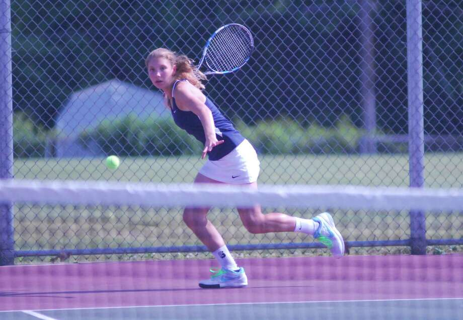 Staples freshman Olivia Foster returns a shot during her match against Glastonbury's Nicole Geradin in the Class L girls tennis semifinals in Glasbonbury, Connecticut on Wednesday, June 3, 2015. Foster won 6-4, 6-1 as Staples advanced to the final. Photo: Ryan Lacey/Staff Photo / Westport News Contributed
