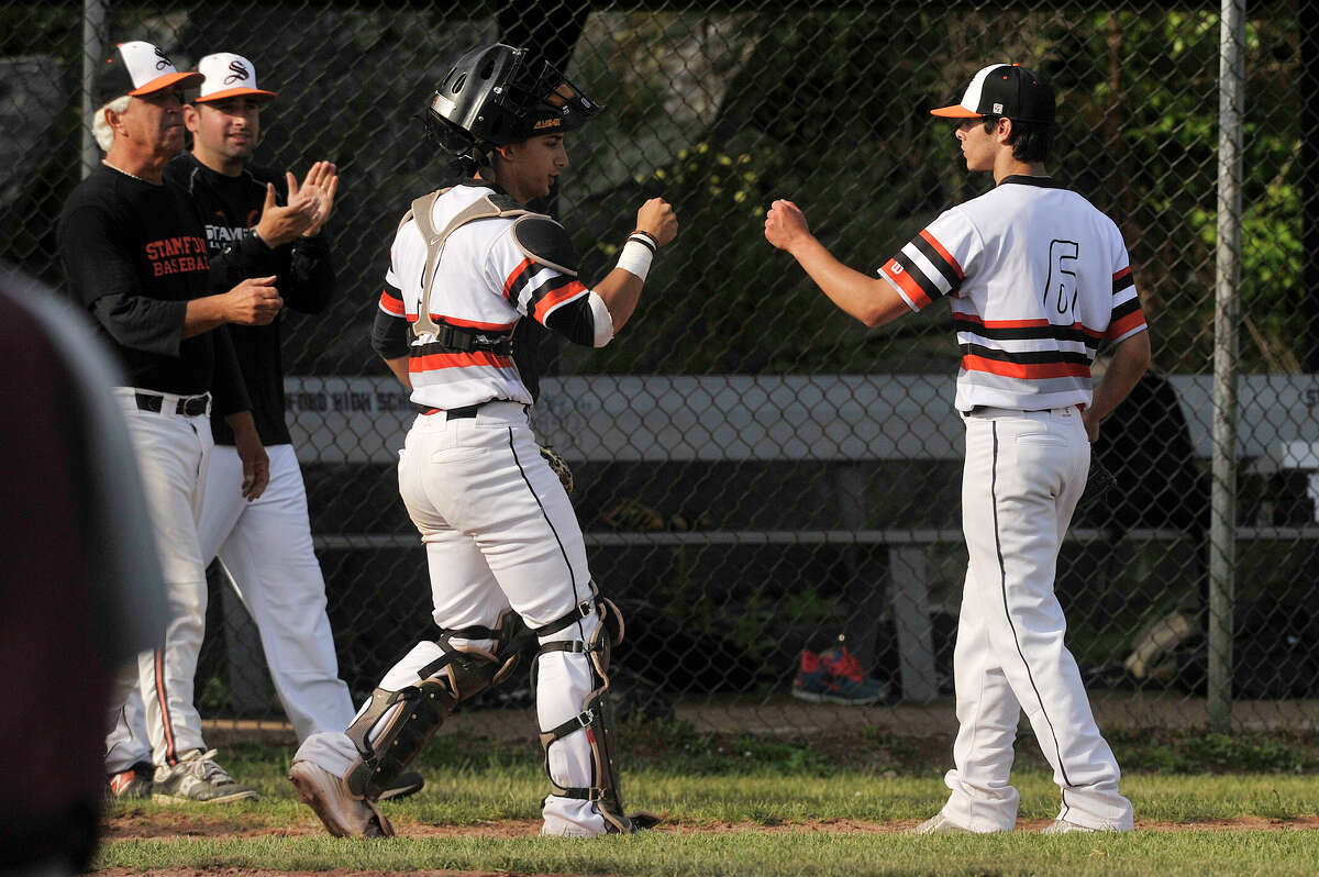 Stamford's Tyler Serricchio, left, congratulates relief pitcher Shawn Urbano after the Black Knights' Class LL first round state playoff win against Naugatuck at Stamford High School in Stamford, Conn., on Wednesday, June 3, 2015. Stamford won, 5-4 and will face Fairfield Prep on Thursday, June 4.