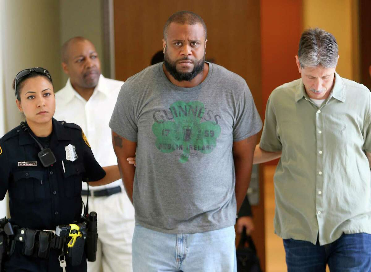 Jamal Darrow is escorted out of the SAPD headquarters building on his way to be booked on murder charges related to the death of Charles Boyd, 85, of New York City.