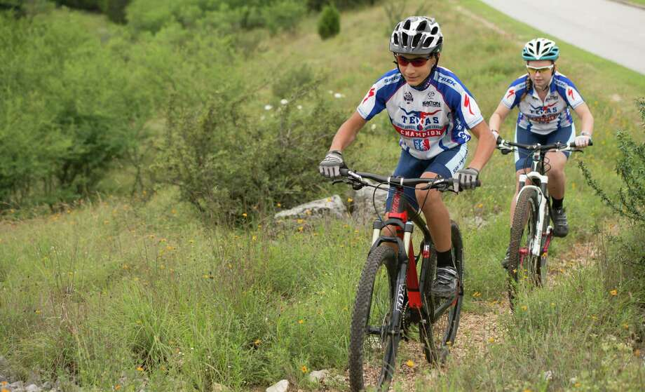 : Jayden Hakala rides a trail on his mountain bike while wearing his champions jersey near Stone Oak Parkway. Hakala won the freshman boys category in the Texas High School Mountain Bike League, which completed its season in early May. Photo: Josh Trudell /For The Express-News