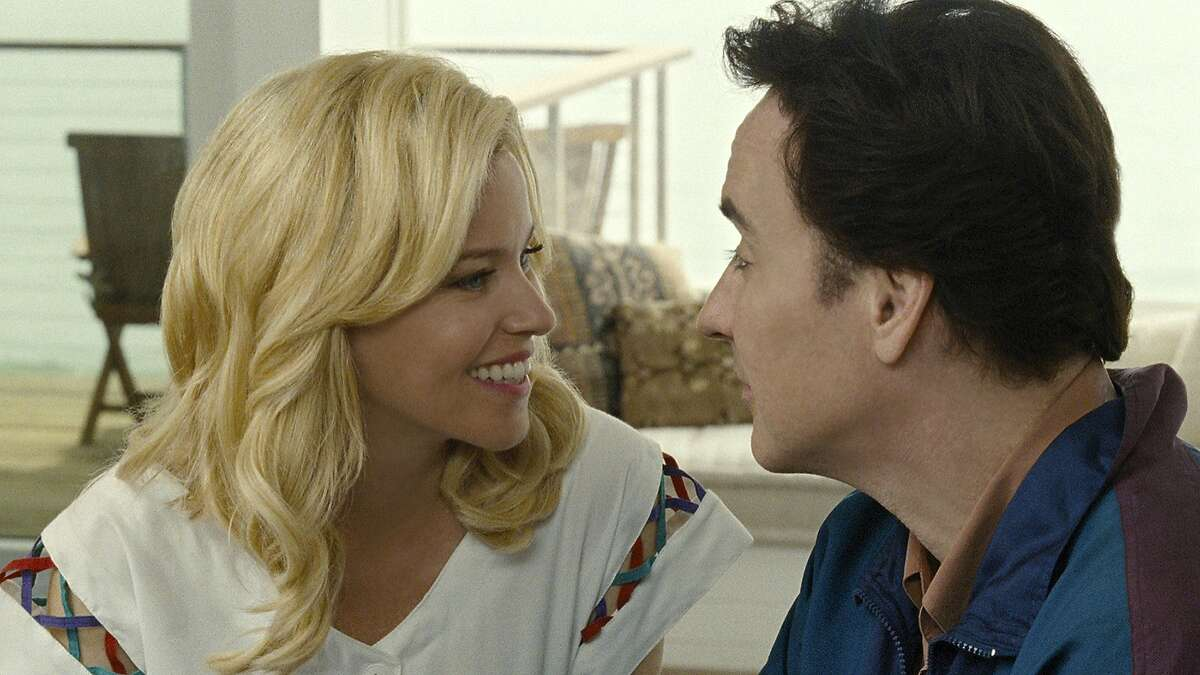 """Elizabeth Banks and John Cusack are Melinda Ledbetter and Brian Wilson in """"Love & Mercy."""" Illustrates FILM-LOVE-ADV05 (category e), by Ann Hornaday © 2015, The Washington Post. Moved Wednesday, June 3, 2015. (MUST CREDIT: Francois Duhamel/Roadside Attractions.)"""