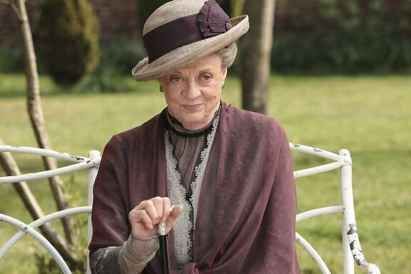 "In this image released by PBS, Maggie Smith as the Dowager Countess Grantham, is shown in a scene from the second season on ""Downton Abbey."" Producers of the popular British period drama on Thursday, March 26, 2015, confirmed it will end after its sixth season, scheduled to air in the U.S. in early 2016. The series, which airs earlier in England, will have its finale on Christmas Day, 2015. (AP Photo/PBS, Carnival Film & Television Limited 2011 for MASTERPIECE, Nick Briggs)"