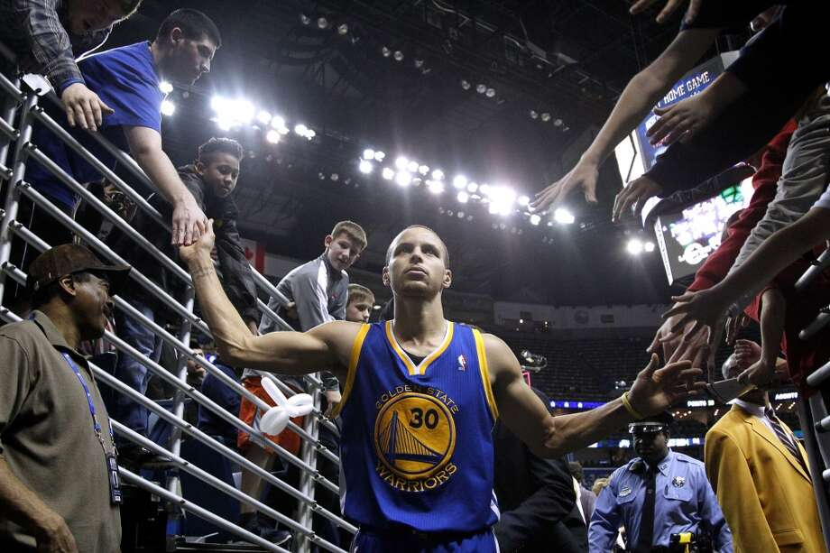 Golden State Warriors point guard Stephen Curry (30) greets fans after an NBA basketball game in New Orleans, Saturday, Jan. 18, 2014. The Warriors won 97-87.(AP Photo/Jonathan Bachman) Photo: Jonathan Bachman, Associated Press