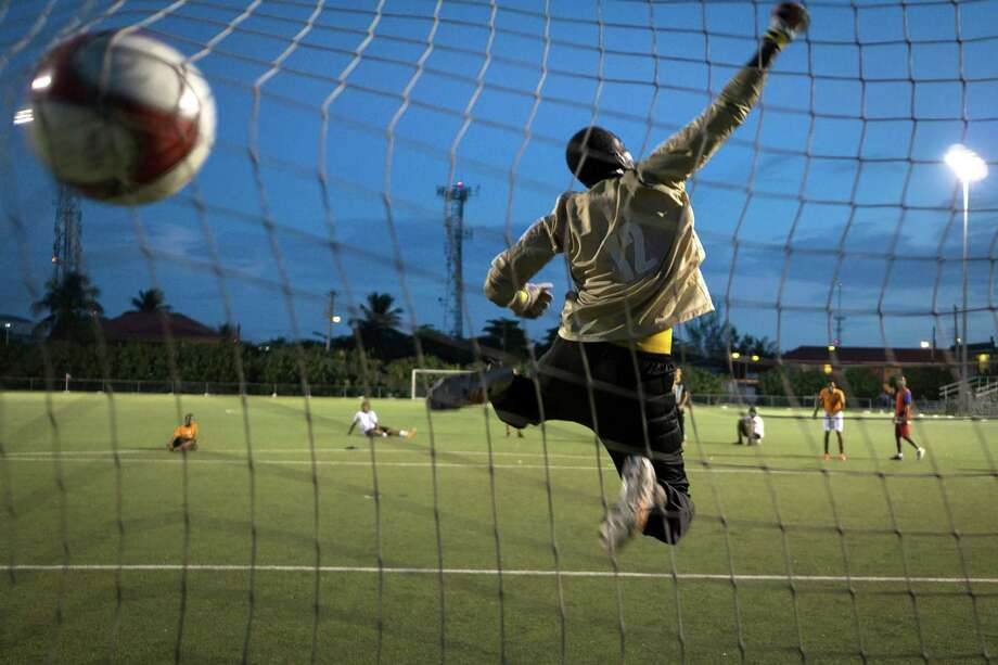 Kason Stewart protects the goal during a free kick session at the Annex in George Town, Cayman Islands. The Caymans became central to a racketeering and bribery scandal that engulfed the sport last week. Why should the U.S. carry the burden of cleaning up the sport? Photo: ANGEL VALENTIN /New York Times / NYTNS