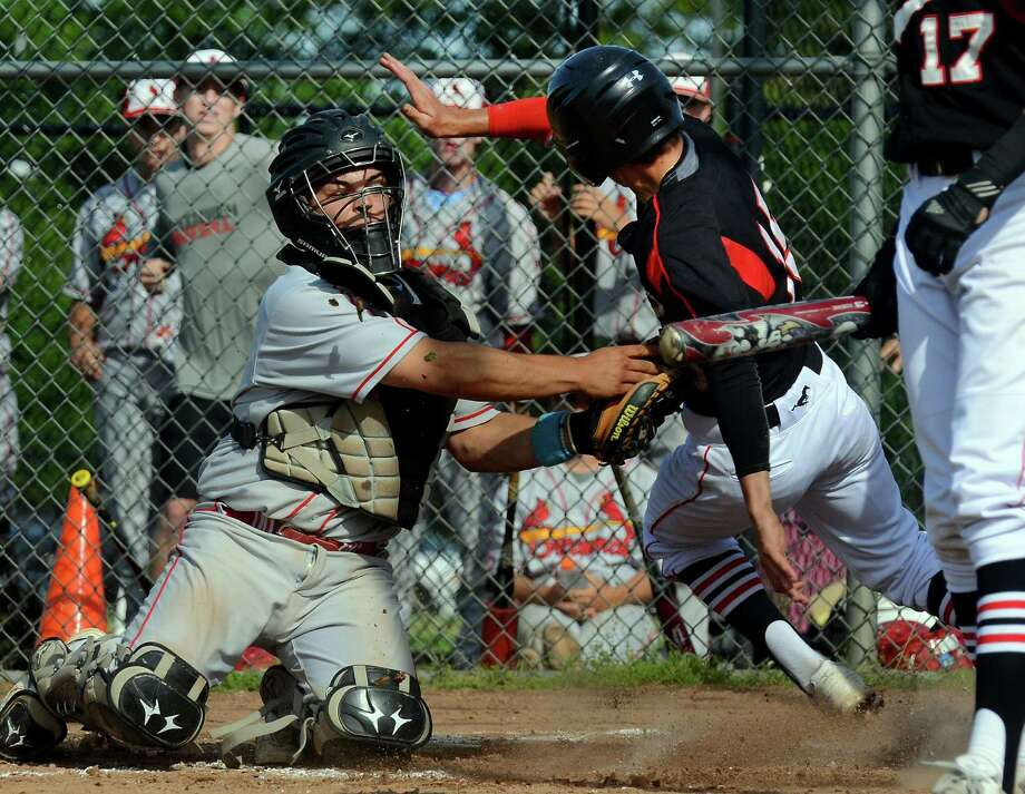 Greenwich catcher Jason Capozza tags out Fairfield Warde's Joseph Deutch at home plate, during Class LL baseball action in Fairfield, Conn., on Wednesday June 3, 2015. Photo: Christian Abraham / Connecticut Post