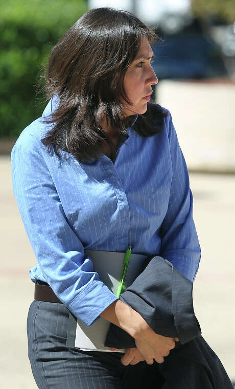 Former city employee Irene Morales.  walks into the Federal Court at 655 E. Ceasar Chavez to plea guilty to bribery and fraud related charges on October 16, 2014. Photo: TOM REEL, Staff / San Antonio Express-News / San Antonio Express-News