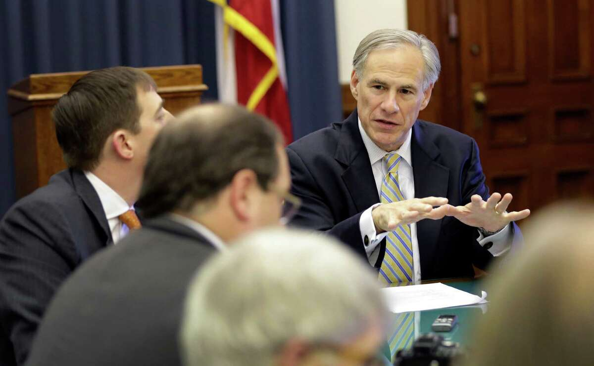 Texas Gov. Greg Abbott, seen here talking with reporters in his office at the Texas Capitol on June 3, advocates in a National Review opinion piece that Congress and the states do nothing if the Supreme Court rules against the Affordable Care Act.