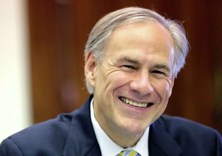 Texas Gov. Greg Abbott shares a laugh with news reporters during a round table talk in his office at the Texas Capitol, Wednesday, June 3, 2015, in Austin, Texas. (AP Photo/Eric Gay) Photo: Eric Gay, STF / Associated Press / AP