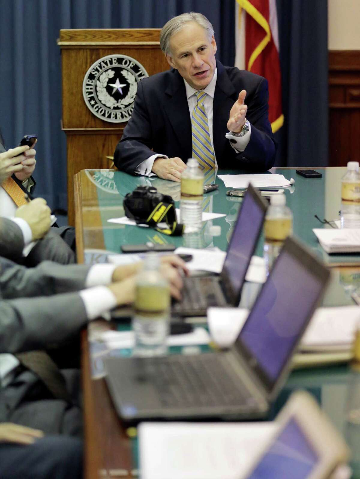 Texas Gov. Greg Abbott talks with news reporters during a round table talk in his office at the Texas Capitol, Wednesday, June 3, 2015, in Austin, Texas. (AP Photo/Eric Gay)